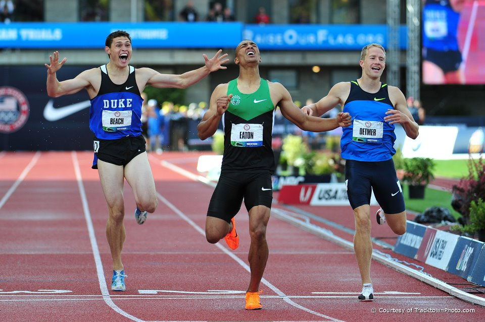 The world record holders in decathlon and in double decathlon at the finish line in Eugene